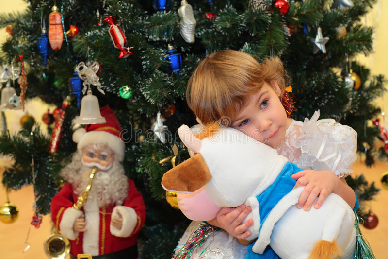 Download Girl With Soft Toy Under New Year`s Tree Stock Image - Image of happy, good: 9155767