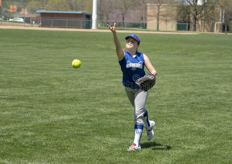 Girl softball pitcher warming up before a game royalty free stock image