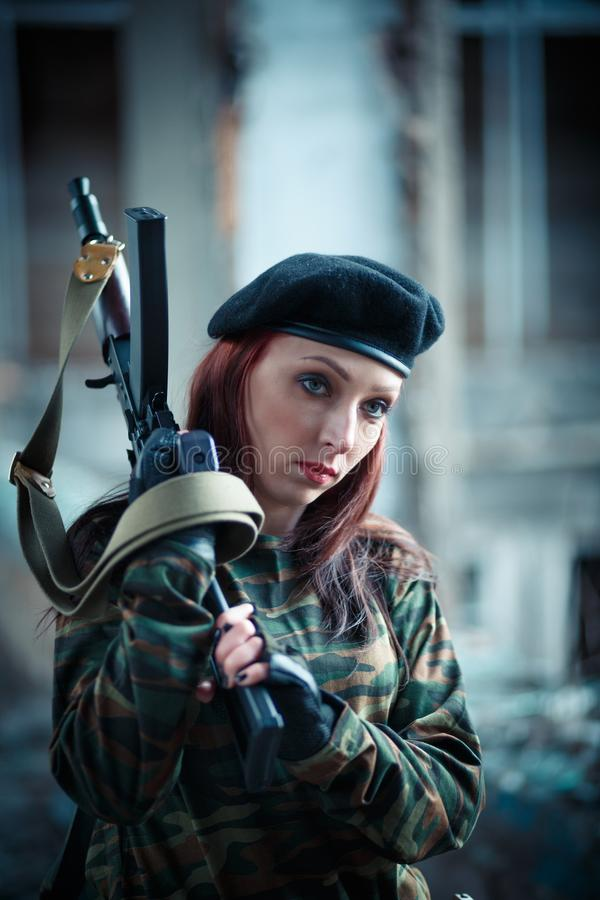 Girl soldier in uniform. The girl in the black beret. Camouflage t-shirt on the girl royalty free stock images