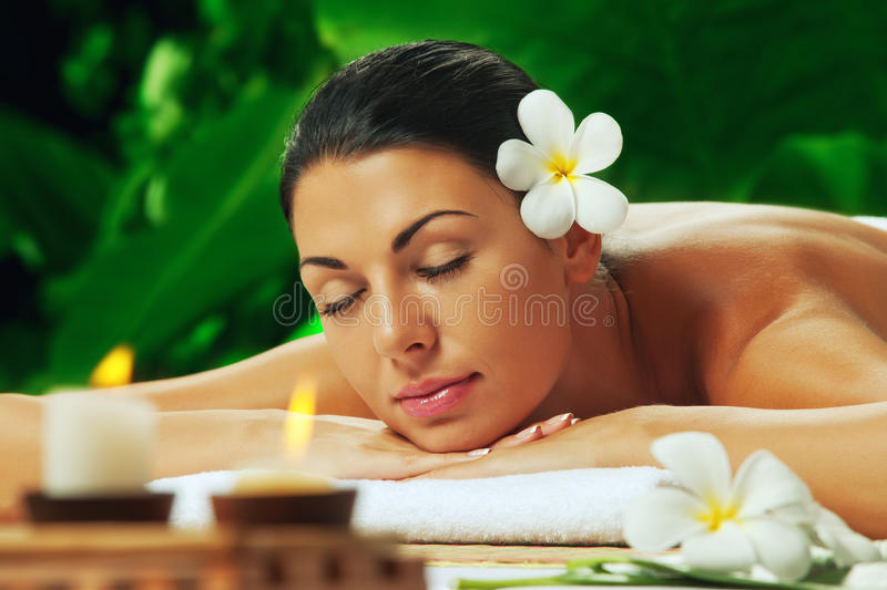 Girl in spa. Portrait of young beautiful woman in spa environment stock photos