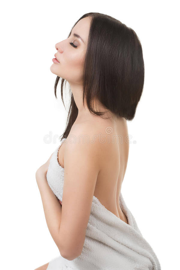 Girl in Spa salon after cosmetic procedures. The beautiful girl with a make-up in Spa salon after cosmetic procedures keeps hair stock images