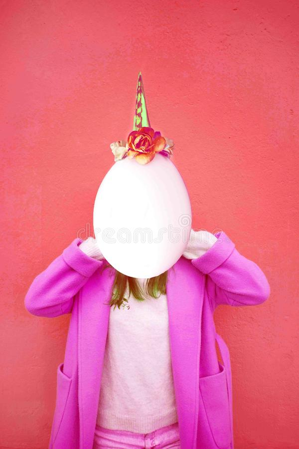 Girl with space instead of a face and egg head with unicorn decoration. Contemporary art collage. Concept of memphis style posters royalty free stock images
