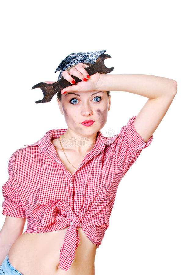 Girl With Spanner Wiping Her Brow Stock Photography