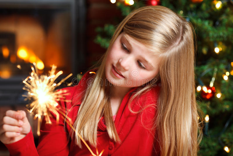 Girl With Sparkler Stock Photos