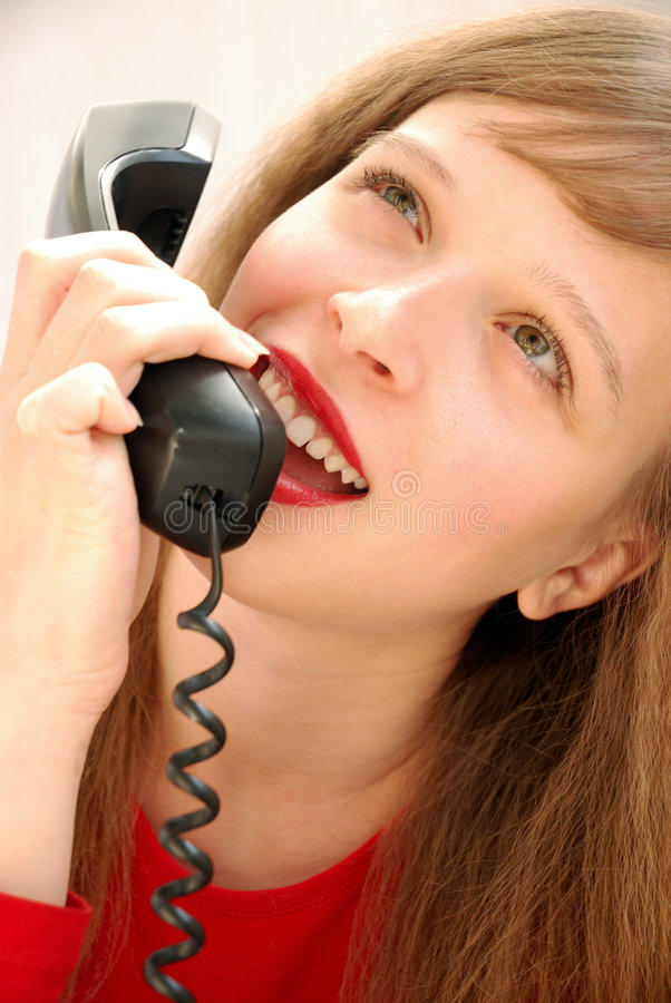 Girl speaking with telephone stock image
