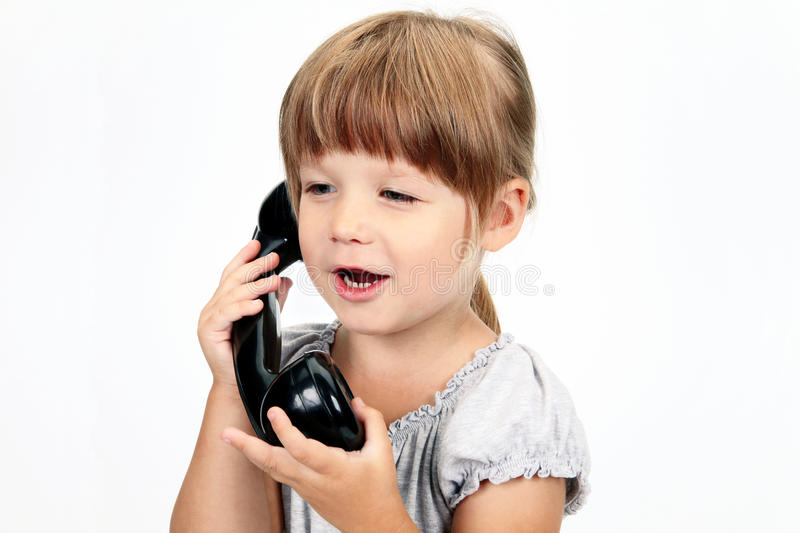 The Girl Speaks By Phone Royalty Free Stock Photography