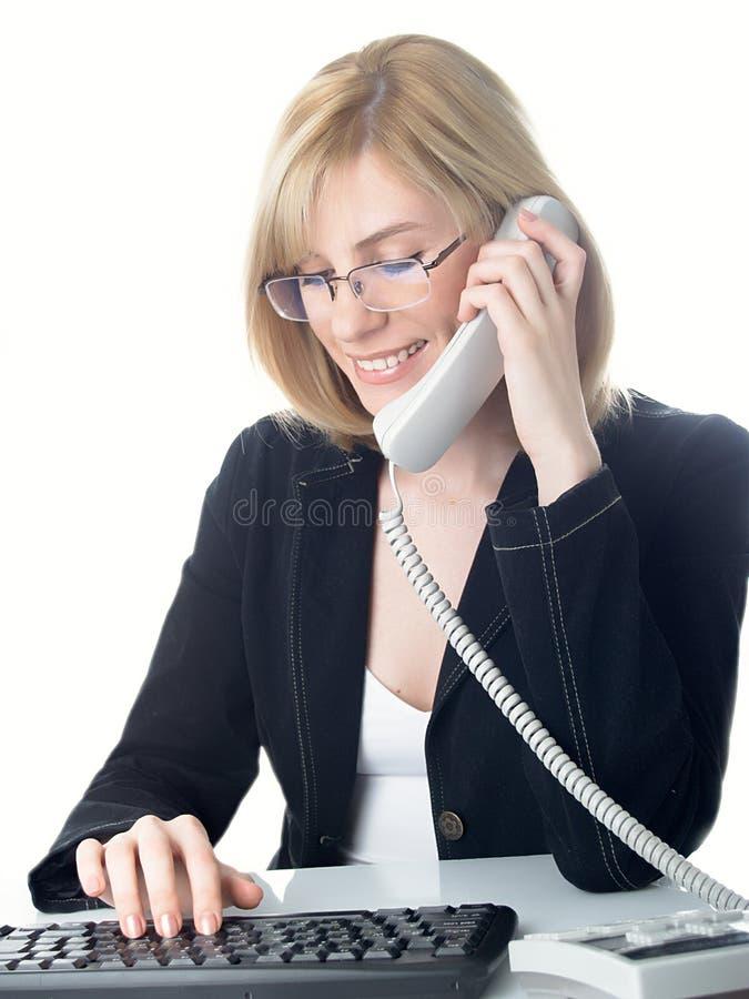 The girl speaks on the phone stock photos
