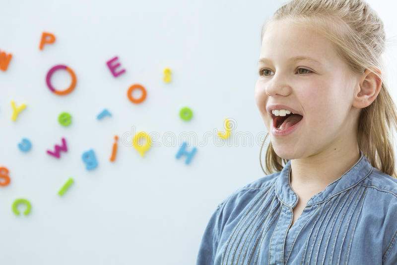 Girl in speech therapy office royalty free stock photos