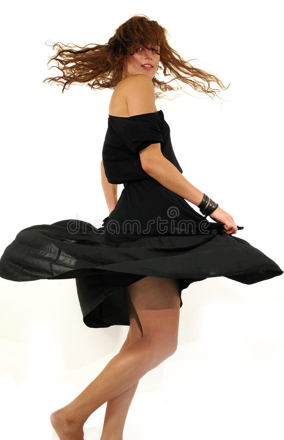 Girl spinning around isolated royalty free stock image