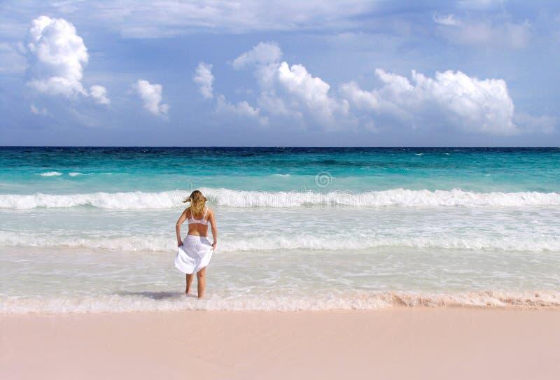 Girl splashes in surf stock photos