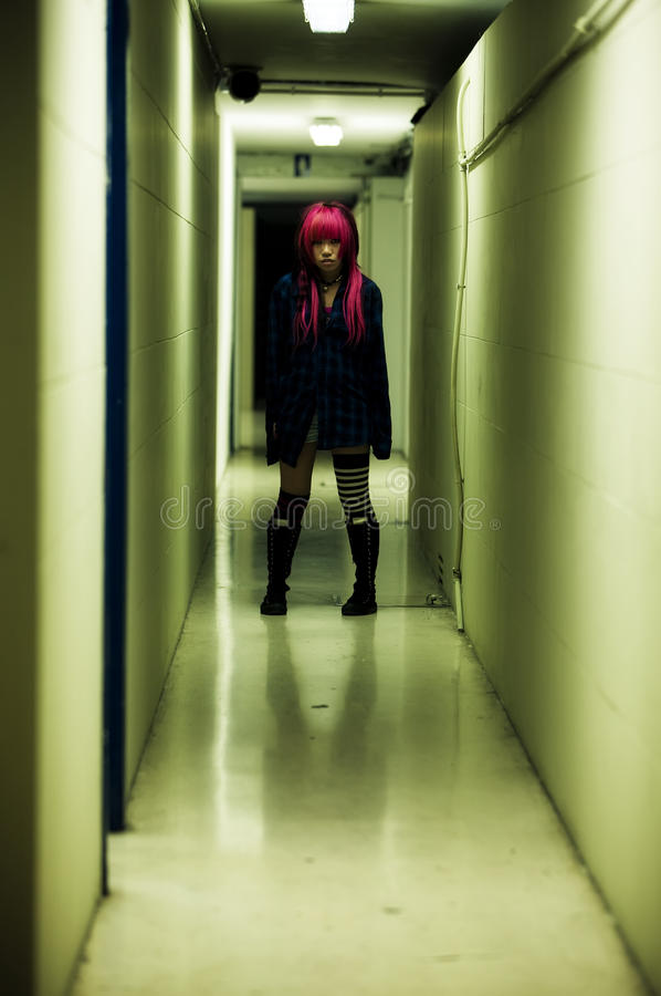 Girl in spooky corridor royalty free stock image