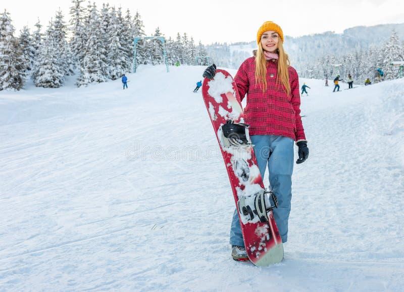 Girl snowboarder smile, winter sport activity stock image