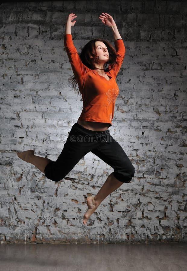 Girl in sportswear jumping royalty free stock photo