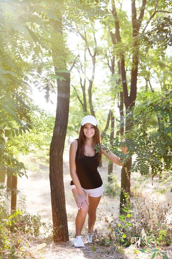 Girl in sportswear for a run outdoors. Girl in sportswear for a run stock photo