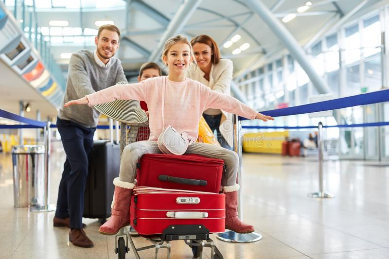 Girl spreads her arms and sits on suitcases royalty free stock image