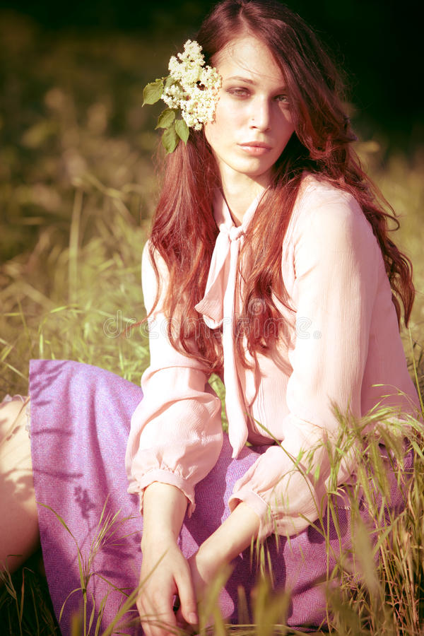 Download Girl in spring meadow stock photo. Image of light, redhead - 24774758