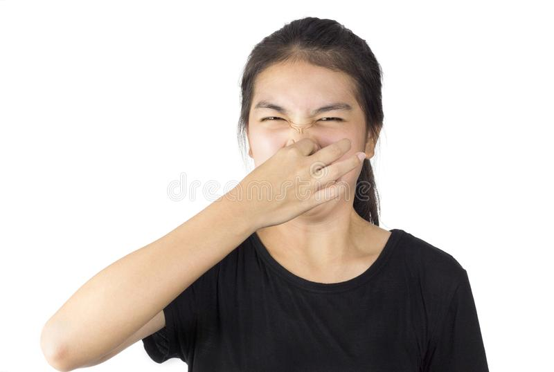 Smell foul. Girl squeeze the nose emotion smell foul royalty free stock photos
