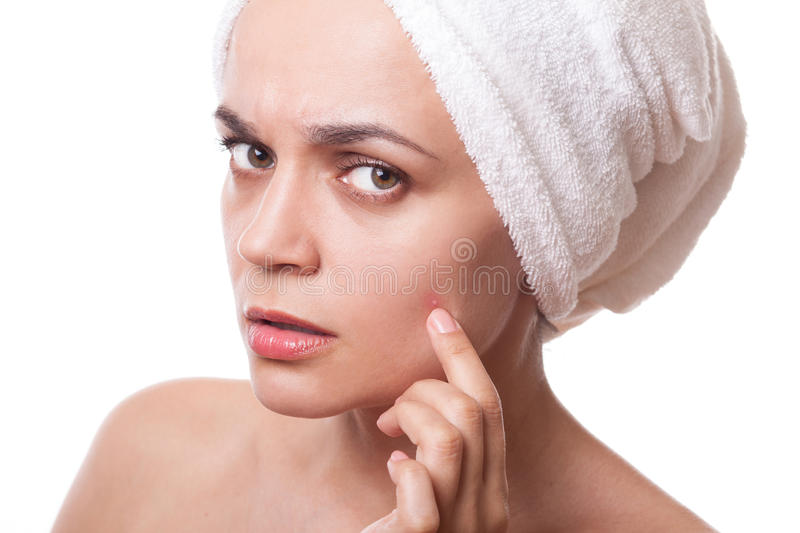 Girl squeezing pimple stock photo