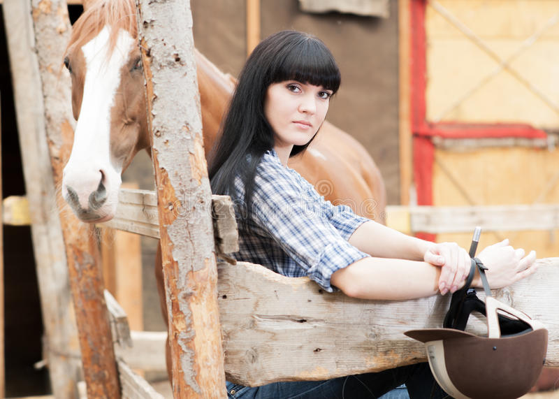 The girl in the stables royalty free stock image