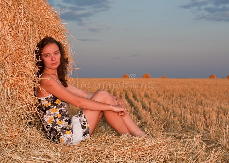 Girl In Stack Of Hey Stock Image