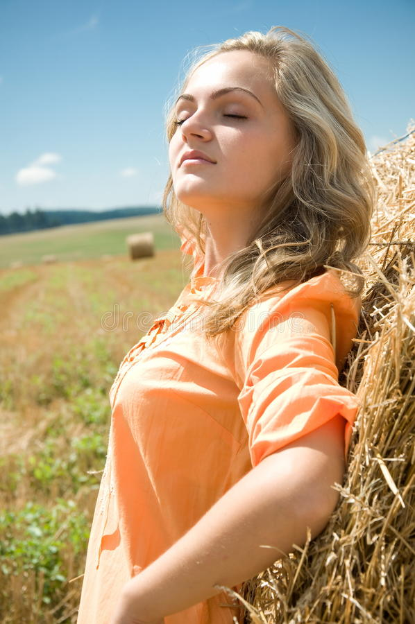 Download Girl at a stack of straw stock photo. Image of orange - 20839464