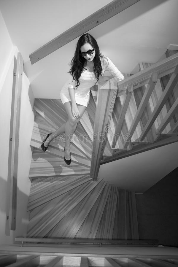 Girl in stairwell stock image
