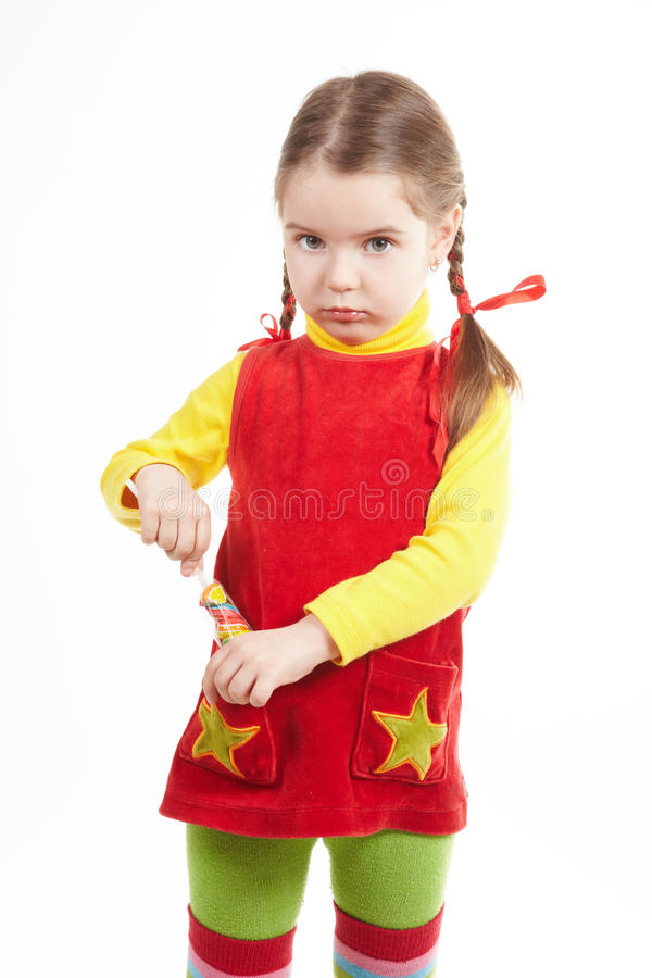 Girl stand with candy royalty free stock photos