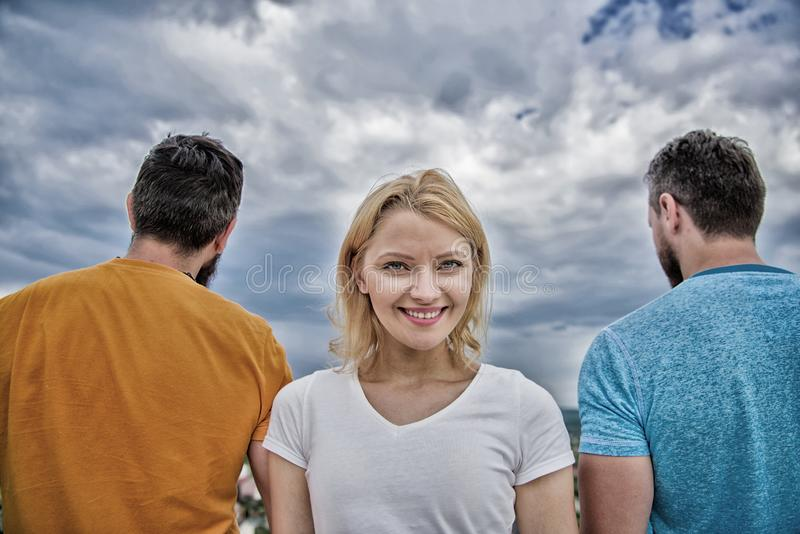 Girl stand in front two faceless men. Best traits of great boyfriend. She needs to pick better boyfriend. Everything you royalty free stock images