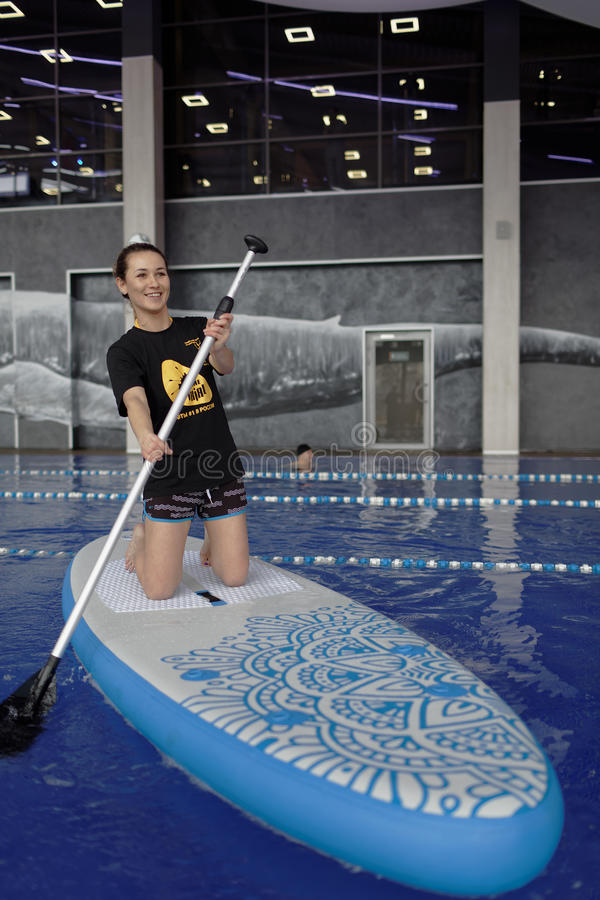 Download Girl On Stand Up Paddle Board In A Swimming Pool Editorial Photography - Image: 93286982