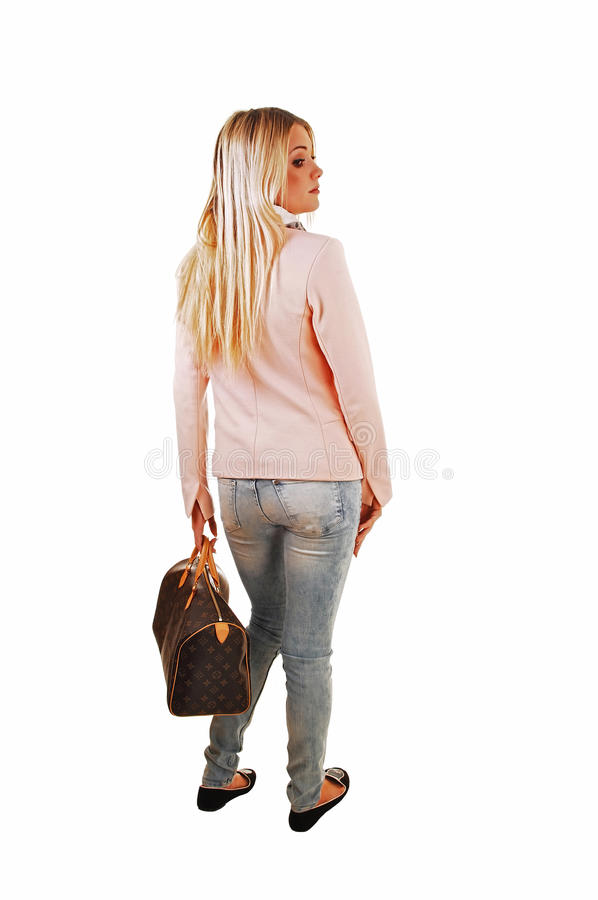 Girl standing from back. stock photos