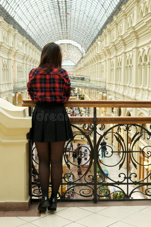 Girl standing with back to the camera stock photography