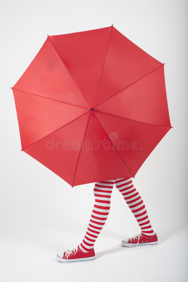 Download The Girl Standing Behind A Large Red Umbrella Stock Photo - Image: 28447598