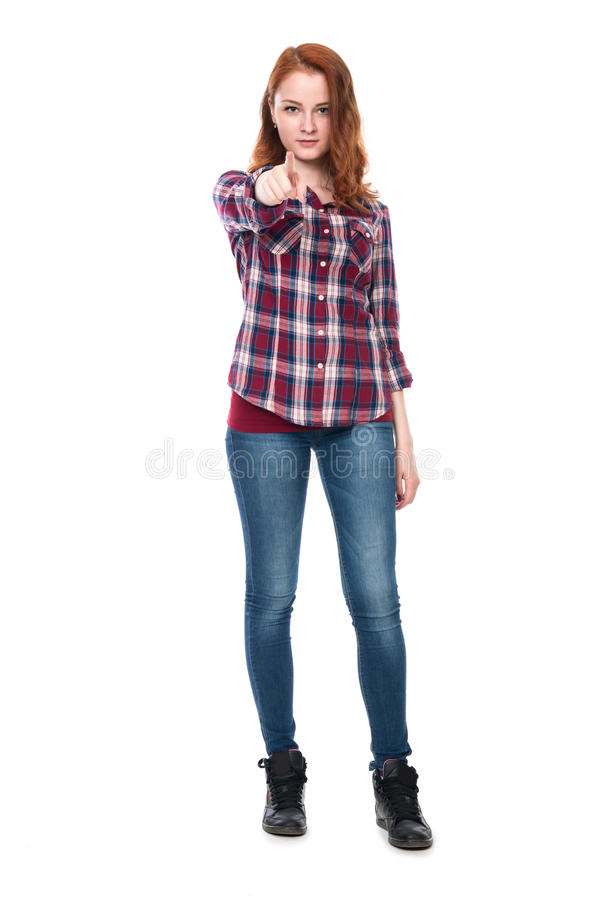 A girl standing in full length confident shows a finger at the c royalty free stock image