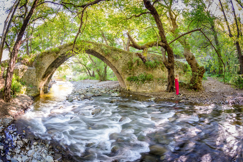 A girl standing by kelefos bridge,cyprus stock photos