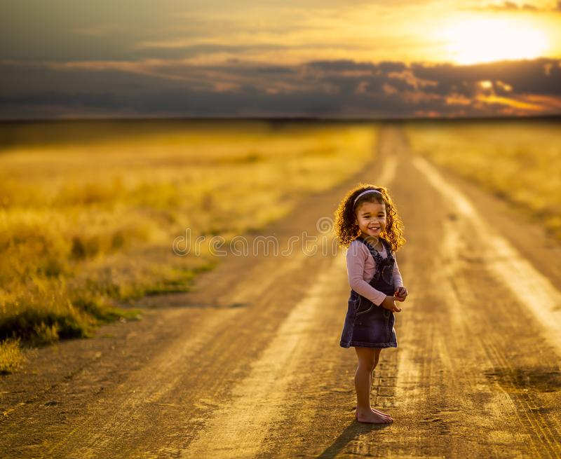 Girl Standing in the Middle of the Road royalty free stock image