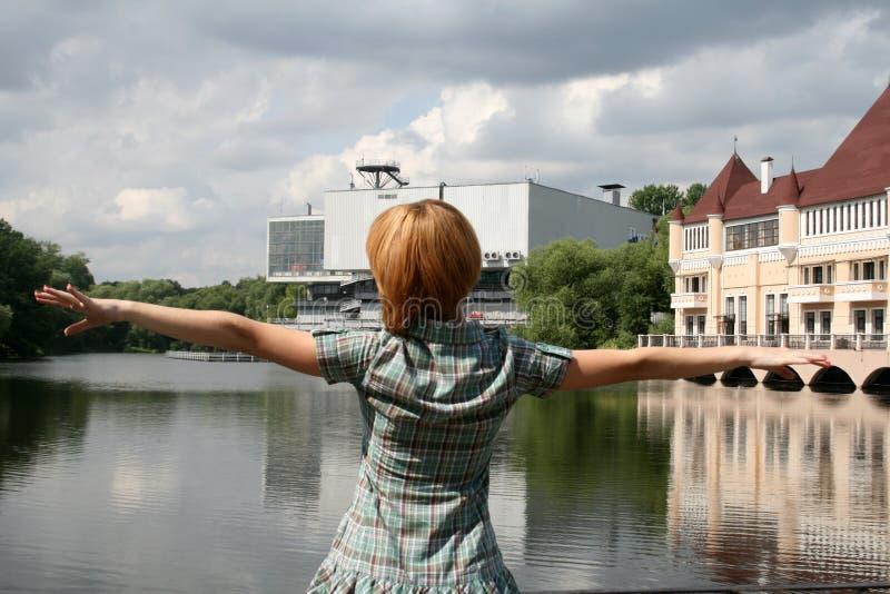 Girl standing near lake stock images