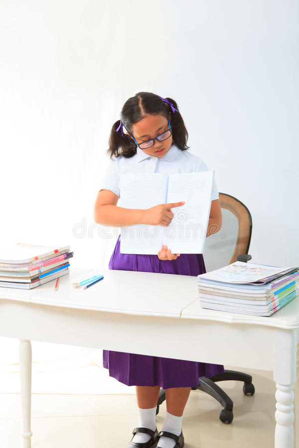 Download Girl Standing And Point A Book In Class Room Stock Photo - Image: 25978680