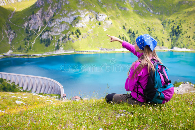 Girl standing and pointing at beautiful scenary