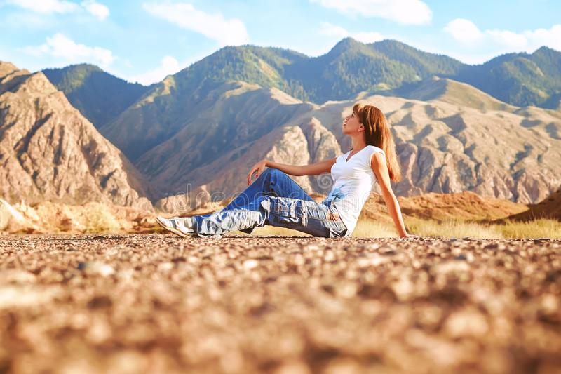 Girl standing on the road with her back royalty free stock photo