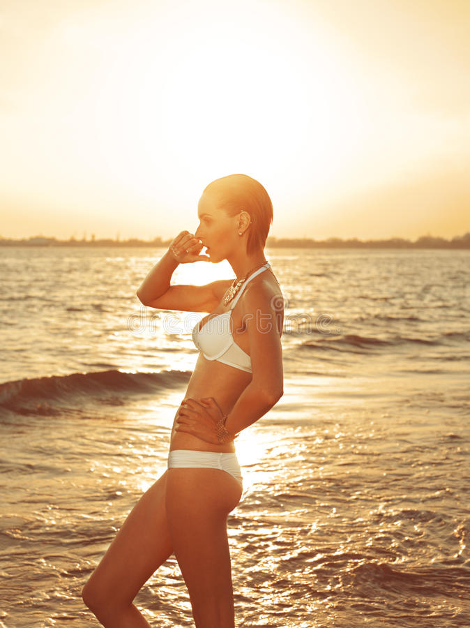 Girl Standing In The Sea Stock Photos