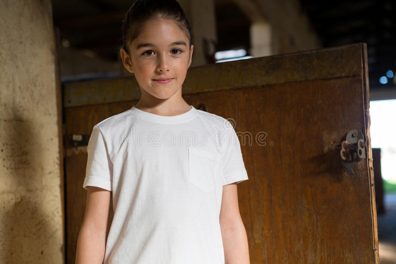 Girl standing in stable royalty free stock photography