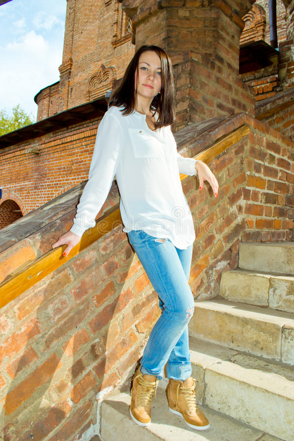 Beautiful Girl Standing Near Wooden House Stock Image
