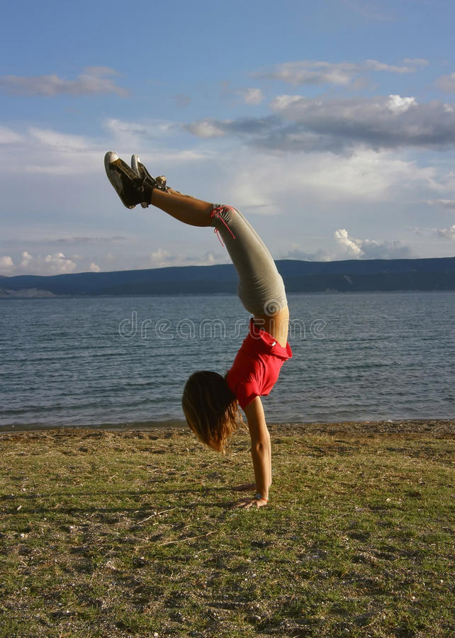 Girl Standing Upside Down 2 Royalty Free Stock Images