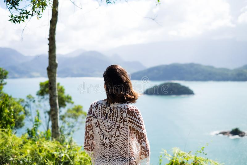 Girl in a viewpoint in Picinguaba, Rio de Janeiro, Brazil royalty free stock images