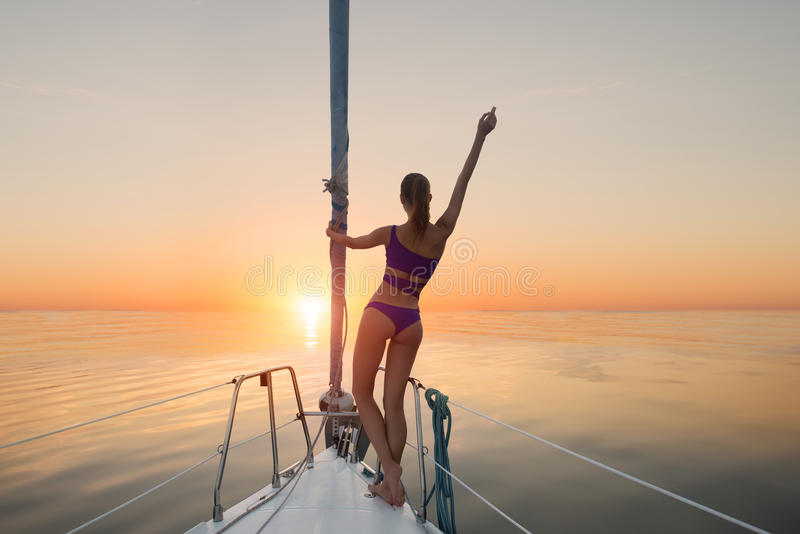 Girl standing on yacht bow. stock photography