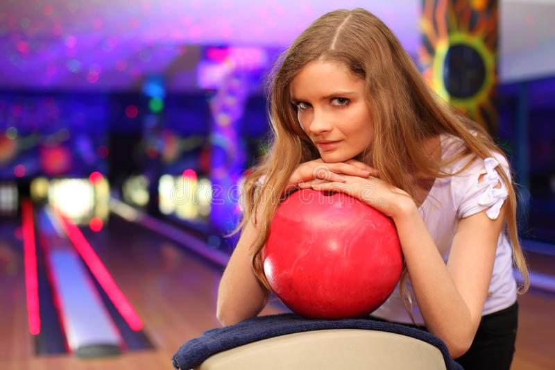 Download Girl Stands And Bases On Ball In Bowling Club Royalty Free Stock Image - Image: 22736086