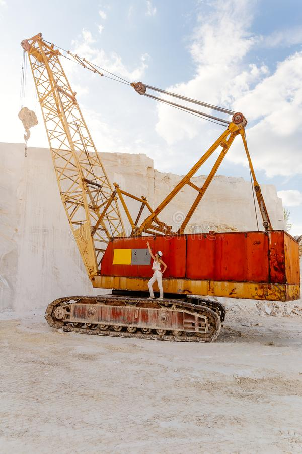 The girl stands on a large crawler crane royalty free stock photography