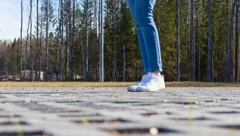 Girl stands on modern urban paving stones stock photography