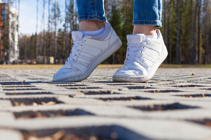 Girl stands on modern urban paving stones, close-up stock image
