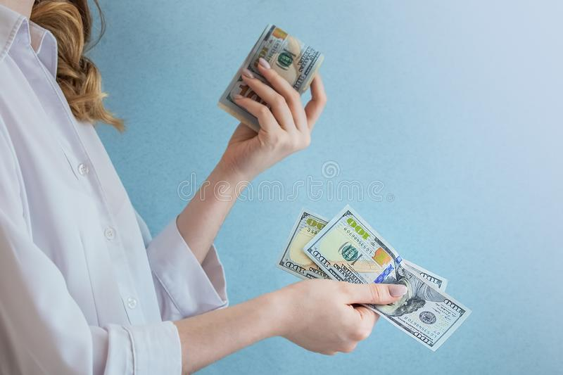 Pay dollars in female hands stock photo